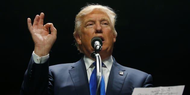 Republican presidential nominee Donald Trump attends a campaign rally in Manchester, New Hampshire, U.S. November 7, 2016.   REUTERS/Carlo Allegri