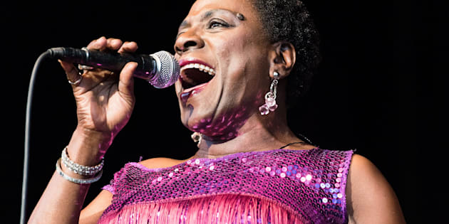 ALPHARETTA, GA - JULY 17:  Sharon Jones of Sharon Jones & The Dap Kings performs on stage at Verizon Wireless Amphitheatre at Encore Park on July 17, 2015 in Alpharetta, Georgia.  (Photo by Paul R. Giunta/Getty Images)