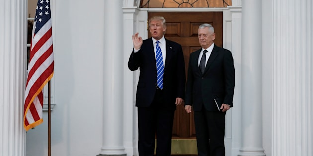 U.S. President-elect Donald Trump stands with retired Marine Gen. James Mattis following their meeting at the main clubhouse at Trump National Golf Club in Bedminster, New Jersey, U.S., November 19, 2016.  REUTERS/Mike Segar