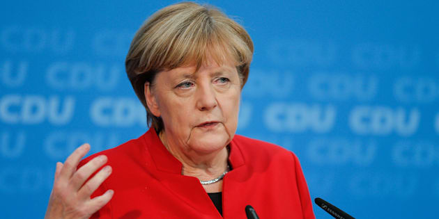 German Chancellor Angela Merkel addresses a news conference, to announce that she will run again for the Chancellorship.