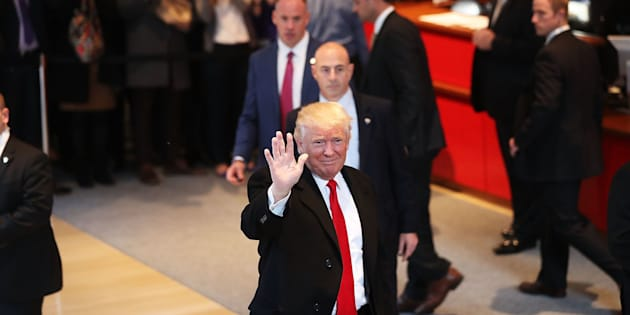 NEW YORK, NY - NOVEMBER 22:  President-elect Donald Trump walks through the lobby of the New York Times following a meeting with editors at the paper on November 22, 2016 in New York City. Trump, who has held meetings with media executives over the last few days, has often had a tense relationship with many mainstream media outlets.  (Photo by Spencer Platt/Getty Images)