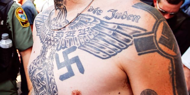 A supporter of the Ku Klux Klan is seen with his tattoos during a rally at the statehouse in Columbia, South Carolina July 18, 2015.