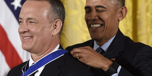 US President Barack Obama presents actor Tom Hanks with the Presidential Medal of Freedom, the nation's highest civilian honor, during a ceremony honoring 21 recipients, in the East Room of the White House in Washington, DC, November 22, 2016. / AFP / SAUL LOEB        (Photo credit should read SAUL LOEB/AFP/Getty Images)