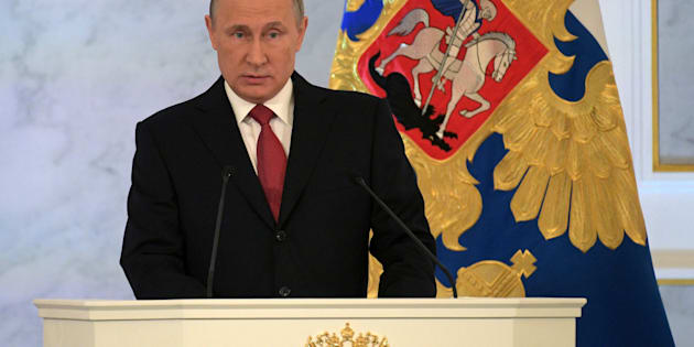 Russian President Vladimir Putin delivers a speech during his annual state of the nation address at the Kremlin in Moscow, Russia, December 1, 2016. Sputnik/Kremlin/Alexei Druzhinin via REUTERS ATTENTION EDITORS - THIS IMAGE WAS PROVIDED BY A THIRD PARTY. EDITORIAL USE ONLY.