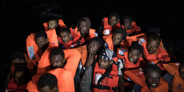 POZZOLLO, ITALY - NOVEMBER 22:  Refugees sit on a FRDC rescue craft after being pulled from a wooden boat as members of MOAS, Migrant Offshore Aid Station make resues on November 22, 2016 in Pozzollo Italy. The MOAS team worked through the night and into the next morning rescuing 'approximately' 600 people from vessels. MOAS are currently patrolling international waters off the coast of Libya, and running rescue missions for the many migrants and refugees who continue to attempt to make the dangerous crossing across the Mediterranean Sea to Italy. MOAS are a Malta based registered foundation dedicated to providing professional search-and-rescue assistance to refugees and migrants in distress at sea and work alongside with the Red Cross on board the Topaz Responder. The number of deaths this year of people crossing the Mediterranean has risen to almost 4,300. MOAS alone have rescued around 19,000.  (Photo by Dan Kitwood/Getty Images)
