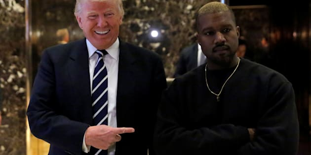 U.S. President-elect Donald Trump and musician Kanye West pose for media at Trump Tower in Manhattan, New York City, U.S., December 13, 2016.  REUTERS/Andrew Kelly      TPX IMAGES OF THE DAY