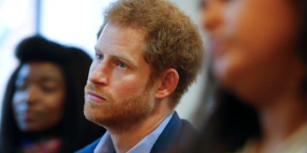 Britain's Prince Harry listens to a seminar for members of staff during a visit to The Mix in London, December 19, 2016. REUTERS/Alastair Grant/Pool