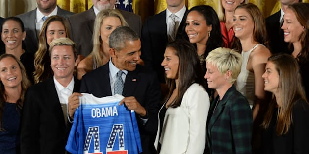 10/24/15- The White House- Washington DC President Barack Obama welcomes the United States Women's National Soccer Team to the White House to honor the team and their victory in the 2015 FIFA Women's World Cup.The President holds up a team jersey they presented to him. photos by: Christy Bowe - ImageCatcher News (Photo by ImageCatcher News Service/Corbis via Getty Images)
