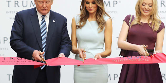 President-elect Donald Trump, Melania Trump and his daughter Tiffany Trump cut the ribbon at the new Trump International Hotel in Washington, DC, on Oct. 26.