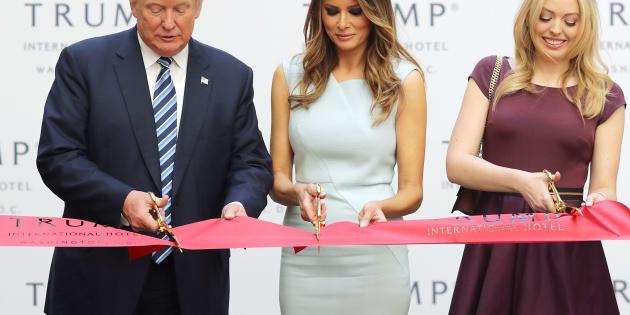 President-electDonald Trump, Melania Trump and his daughter Tiffany Trump cut the ribbon at the new Trump International Hotel in Washington, DC, on Oct. 26.
