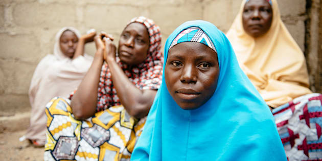 Aisha, 30, (blue hijab) in Biu, Borno State Nigeria. She and her four children were displaced 3 years ago after Boko Haram raided her village and killed her husband and two brothers.