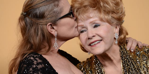 Debbie Reynolds and Carrie Fisher pose in the press room at the 21st Annual Screen Actors Guild Awards at The Shrine Auditorium on January 25, 2015 in Los Angeles, California.