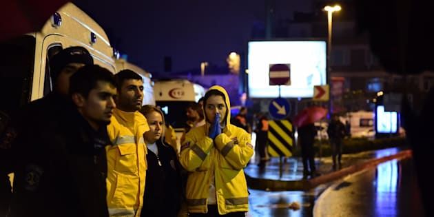A first aid officer reacts at the site of an armed attack January 1, 2017 in Istanbul. At least two people were killed in an armed attack Saturday on an Istanbul nightclub where people were celebrating the New Year, Turkish television reports said. / AFP / YASIN AKGUL        (Photo credit should read YASIN AKGUL/AFP/Getty Images)