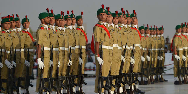 Pakistani military cadets march on the birth anniversary of the country's founder Mohammad Ali Jinnah at his mausoleum in Karachi on December 25, 2016.