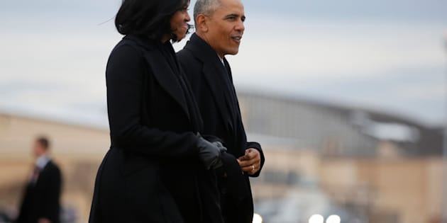 U.S. President Barack Obama and first lady Michelle Obama arrive to board Air Force One for travel to Chicago to deliver a farewell address, from Joint Base Andrews, Maryland, U.S. January 10, 2017. REUTERS/Jonathan Ernst