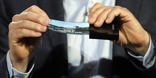 A prototype Windows smartphone with a flexible OLED display is seen during Samsung's keynote address.
