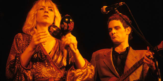 Christine McVie and Lindsey Buckingham performing with Fleetwood Mac.