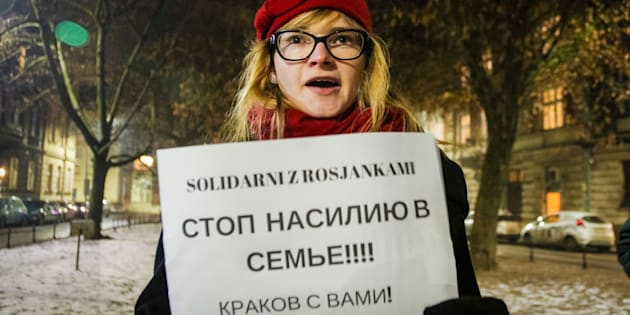 KRAKOW, POLAND - JANUARY 23: A protester holds 'Solidarity with the Russian Women - Stop Domestic and Physical Violence - Krakow with You! ' banner in front of the Russian Consulate General in Krakow in solidarity with Russian Women to demonstrate against the pending bill in Russia that would de-criminalize acts of the domestic violence.  (Photo by Beata Zawrzel/Corbis via Getty Images)