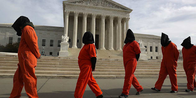 WASHINGTON, DC - JANUARY 11:  Protesters gather in front of the U.S. Supreme Court to mark 15 years since the first prisoners were brought to the U.S. detention facility in Guantanamo Bay, Cuba on January 11, 2017 in Washington, DC.  The protesters were asking President Obama 'to expedite releases from Guantanamo and to make public the full U.S. Senate Torture Report.'  (Photo by Joe Raedle/Getty Images)