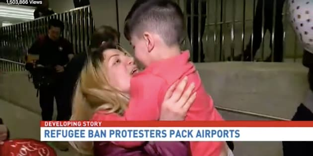 A 5-year-old boy is seen being reunited with his mother after undergoing a several hour detention at Dulles Airport