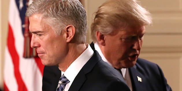 U.S. President Donald Trump steps back as Neil Gorsuch (L) approaches the podium to speak after being nominated to be an associate justice of the U.S. Supreme Court at the White House in Washington, D.C., U.S., January 31, 2017. REUTERS/Carlos Barria