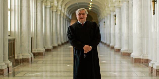 Judge Alex Kozinski isn't assigned tothe three-judge panel considering a federal court's halt of the travel ban.