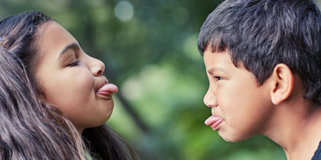 Shot of a young brother and sister teasing each other while playing outside