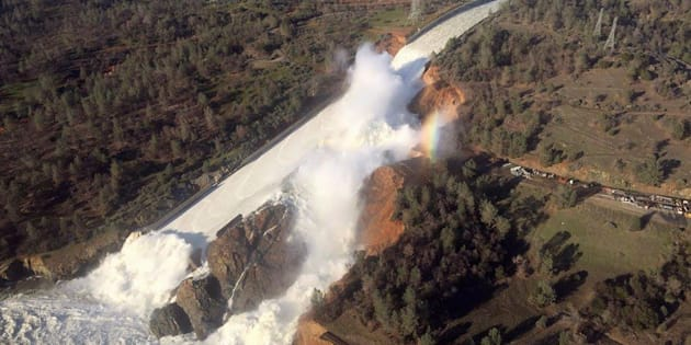 A damaged spillway with eroded hillside is seen Saturday in an aerial photo taken over the Oroville Dam in California.