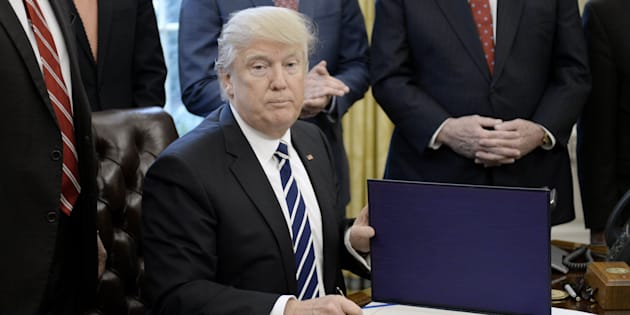 WASHINGTON, D.C. - FEBRUARY 14:  (AFP-OUT) U.S. President Donald Trump signs H.J. Res. 41 in the Oval Office of the White House on February 14, 2017 in Washington, DC. The resolution nullifies a rule in the Dodd-Frank Act that 'requires resource extraction issuers to disclose payments made to governments for the commercial development of oil, natural gas, or minerals.' (Photo by Olivier Douliery-Pool/Getty Images)