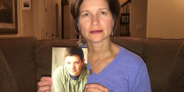 Mindy Corporon holds a photo of her son, Reat Griffin Underwood, who, along with her father, was killed in a 2014 shooting at the Jewish Community Center of Greater Kansas City.