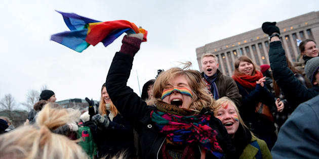 Supporters of same-sex marriage celebrate outside the Finnish Parliament in Helsinki November 28, 2014. The Finnish Parliament on Friday narrowly approved a citizen's initiative to legalise same-sex marriage. Gay couples in Finland have been able to enter into registered partnerships since 2002, but until now the country was the only one in the Nordic region to not allow same-sex marriage. Finland is now the 12th European state to do so.   REUTERS/Mikko Stig/Lehtikuva   (FINLAND - Tags: POLITICS) ATTENTION EDITORS - THIS IMAGE WAS PROVIDED BY A THIRD PARTY. FOR EDITORIAL USE ONLY. NOT FOR SALE FOR MARKETING OR ADVERTISING CAMPAIGNS. THIS PICTURE IS DISTRIBUTED EXACTLY AS RECEIVED BY REUTERS, AS A SERVICE TO CLIENTS. NO THIRD PARTY SALES. NOT FOR USE BY REUTERS THIRD PARTY DISTRIBUTORS. FINLAND OUT. NO COMMERCIAL OR EDITORIAL SALES IN FINLAND