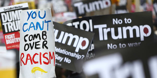 Demonstrators march against U.S. President Donald Trump and his temporary ban on refugees and nationals from seven Muslim-majority countries from entering the United States, during a protest in London, Britain, February 4, 2017. REUTERS/Neil Hall