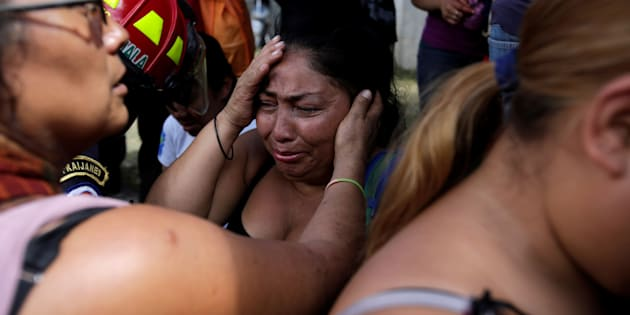 Family members react as they wait for news of their loved ones after a fire broke at the Virgen de Asuncion home in San Jose Pinula, on the outskirts of Guatemala City, Guatemala March 8, 2017.