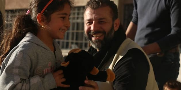 Rami hands out toys to Syrian Children