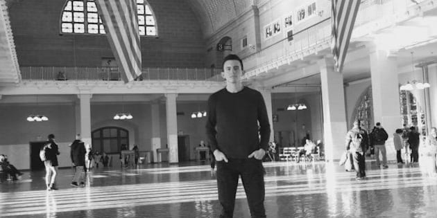 Mancheno, a gay refugee immigration lawyer, visits Ellis Island, where millions of immigrants first landed in the U.S.