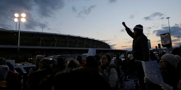 People gather outside Terminal 4 during a protest against Donald Trump's travel ban at John F. Kennedy International Airport in Queens, New York, U.S., January 29, 2017.  REUTERS/Andrew Kelly