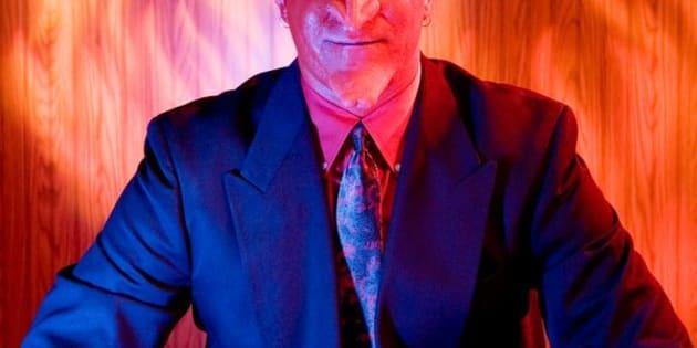 Businessman dressed as devil at desk