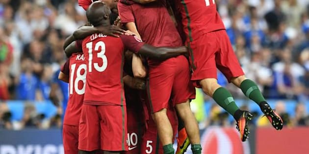 Portugal players celebrate after they scored a goal during the Euro 2016 final football match between Portugal and France at the Stade de France in Saint-Denis, north of Paris, on July 10, 2016. (FRANCISCO LEONG/AFP/Getty Images)