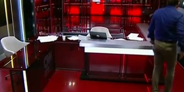 The CNN Turk's anchor chair is empty as the arrival of soldiers on Saturday morning forces them to stop broadcasting.