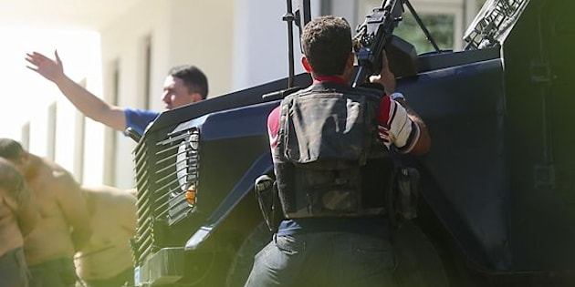 Turkish forces taken soldiers into custody at the Gendarmerie General Command's building in Ankara on July 16. Turkish officials say they have detained a least 6,000 in connection to Friday's coup attempt.