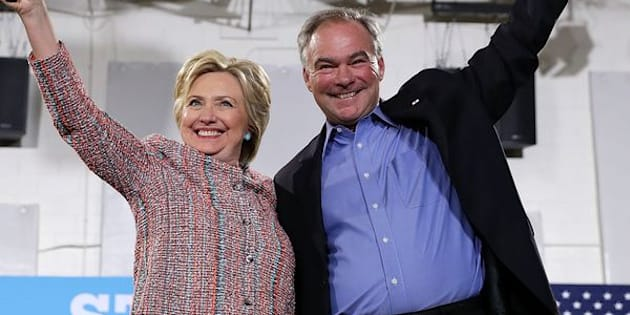 ANNANDALE, VA - JULY 14:  Democratic presidential candidate Hillary Clinton (L) and U.S. Sen. Tim Kaine (D-VA) (R) acknowledge the crowd during a campaign event at Ernst Community Cultural Center at Northern Virginia Community College July 14, 2016 in Annandale, Virginia. Hillary Clinton continued to campaign for the general election in November.  (Photo by Alex Wong/Getty Images)