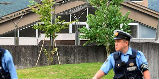 Police officers are seen in front of a facility for the disabled where a knife-wielding man attacked numerous people, in Sagamihara, Kanagawa prefecture, Japan.