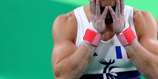 France's Danny Pinheiro Rodrigues reacts after teammate Samir Ait Said brokehis leg while competing on the vault on Day 1 of the Rio 2016 Olympic Games.
