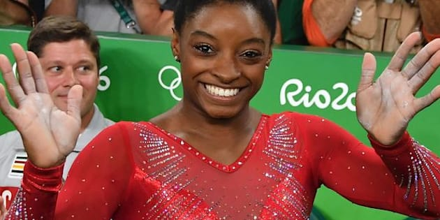 US gymnast Simone Biles celebrates after competing in the women's vault event final of the Artistic Gymnastics at the Olympic Arena during the Rio 2016 Olympic Games in Rio de Janeiro on August 14, 2016. / AFP / Ben STANSALL        (Photo credit should read BEN STANSALL/AFP/Getty Images)