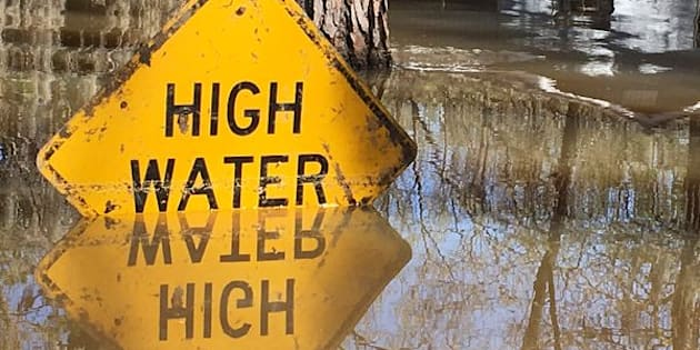 A high water sign is submerged near Lake Bistineau in Webster Parish, Louisiana March 14, 2016. The death toll from storms in Southern U.S. states rose to five as storm-weary residents of Louisiana and Mississippi watched for more flooding on Monday from drenching rains that inundated homes, washed out roads and prompted thousands of rescues.    REUTERS/Therese Apel  TPX IMAGES OF THE DAY