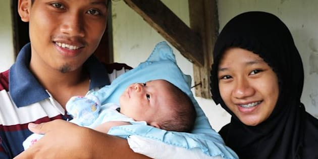 Anggit Bayu Saputro (left), age 21, and Wadianti, age 19, became parents five years before they'd planned. They feared using contraception and had little access to it as an unmarried couple.