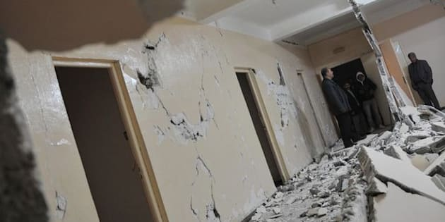 Algerian men inspect a damaged clinic building following an earthquake in Beni Yellman village, 260 km east of Algiers, on May 14, 2010. A moderate earthquake in Algeria on Friday killed two people and injured 43 others, the interior ministry reported. AFPP HOTO/FAYEZ NURELDINE (Photo credit should read FAYEZ NURELDINE/AFP/Getty Images)
