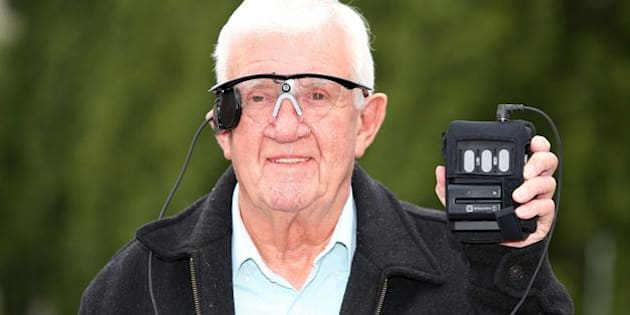 """Partially sighted pensioner Raymond Flynn, 80, from Audenshaw, Manchester, speaks during a press conference at the Manchester Royal Infirmary, after he had his central vision restored for the first time in nearly a decade after he received a """"bionic eye"""", and is the world's first patient with advanced dry Age Related Macular Degeneration (AMD) to undergo the procedure."""