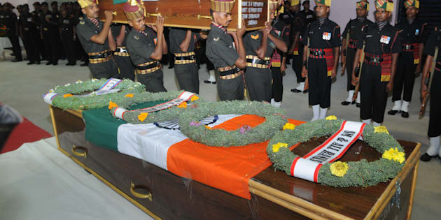 Army personnel arranging remains of Late Martyrs Naiman Kujur and Jawara Munda, Jharkhand, and SK Vidyarthi, Varanashi, for tribute, who were killed in Uri terror attack, at Birsa Munda Airport on September 19, 2016 in Ranchi.