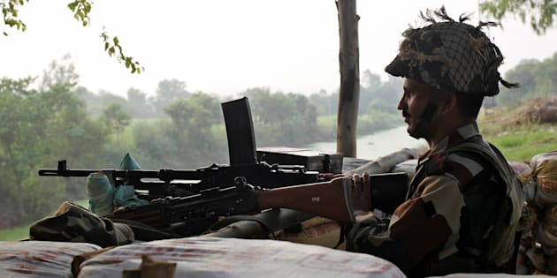 An Indian army soldier keeps guard from a bunker near the border with Pakistan in Abdullian, southwest of Jammu, September 30, 2016. REUTERS/Mukesh Gupta